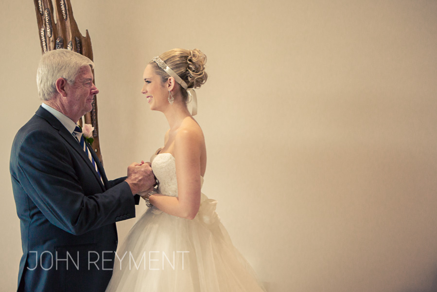 A candid bride and father wedding day moment by Brisbane wedding photographer John Reyment