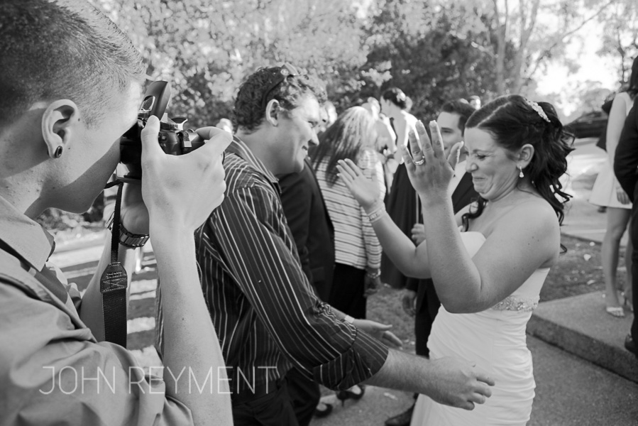 A candid moment at a Sirromet Winery wedding by Brisbane wedding photographer John Reyment