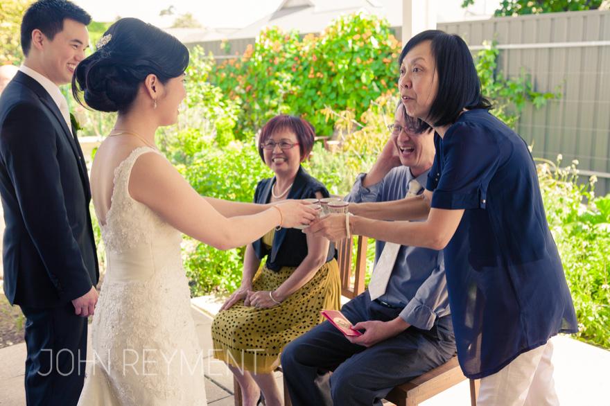 Tea ceremony, Tania & Justin's Adelaide wedding by wedding photographer John Reyment